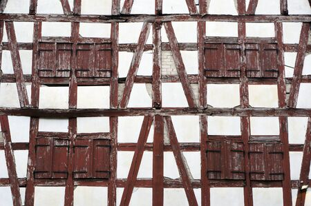 Wall and windows of old half-timbered house in Klaipeda, Lithuania.