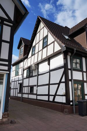 Bodenwerder, Germany - April 20, 2016: Narrow medieval street in Bodenwerder, Lower Saxony, Germany.