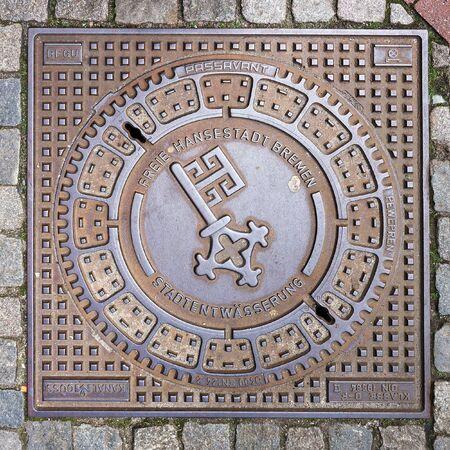 Bremen, Germany - April 21, 2016: Key - Emblem of city Bremen on metal manhole cover. Redakční