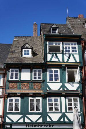 Goslar, Germany - April 21, 2016: Decorated facade of old medieval half-timbered house. Redakční