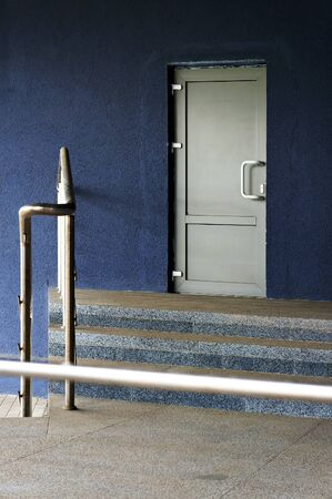 Closed white door of entrance in modern building.