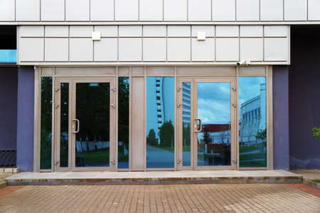 Closed glass doors of entrance in modern building.