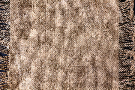 Closeup of rough canvas sackcloth with fringe. Stock Photo