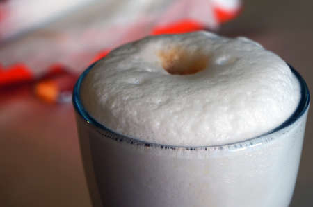Closeup of latte - coffee with frothy milk. Selective focus.
