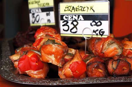 Shashlik of smoked salmon with tomatoes on skewers.