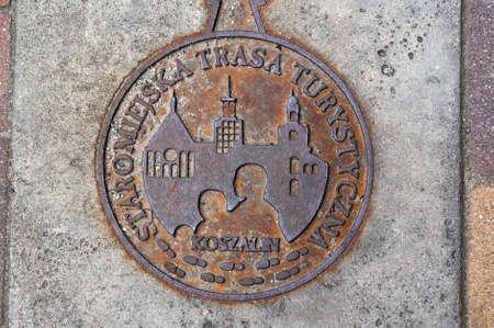 Koszalin, Poland- July 29, 2015: Metal manhole cover in old town of Koszalin..