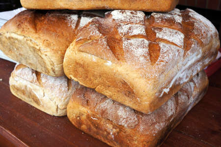Traditional wheat bread on wooden table.