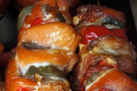Kebab shashlik of smoked salmon with vegetables on skewers. Selective focus.