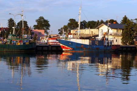 Darlowko, Poland - July 24, 2015: Fishing boats on river Wieprza in Darlowko - popular resort at Baltic Sea. Éditoriale