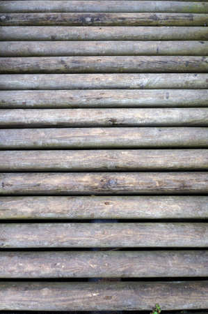 Wooden logs of foot bridge. Wood textured background.