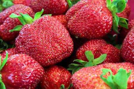 Closeup of fresh ripe juicy red strawberries.