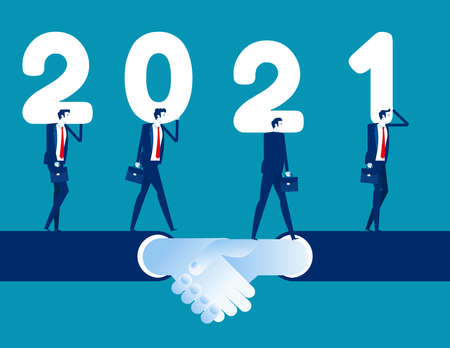 Business team walk together on shaking hand and hold number 2021