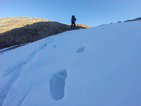 Shoe prints in snow, hiking the mountain, Tor de Mont Blanc