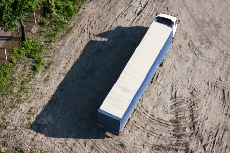 The long truck on parking in a bright sunny day  Top view  photo