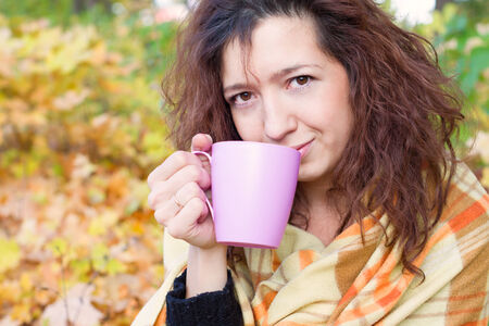 warm drink: Girl basking with a warm drink in hand