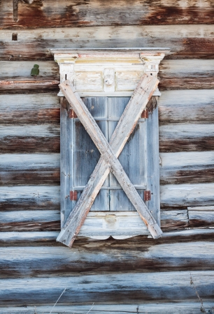 boarded: Old boarded window in an abandoned house
