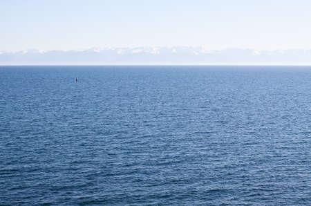 listvyanka: Single buoy floating in Lake Baikal