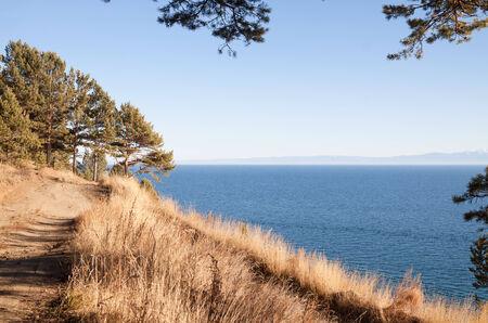listvyanka: Autumn footpath along the shore of Lake Baikal. Russia Stock Photo
