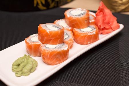philadelphia roll: Philadelphia roll, wasabi and ginger on a white plate Stock Photo