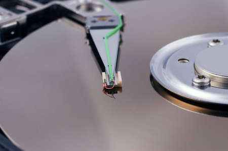 read head and disc of an opened harddisk photo