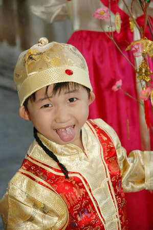 young chinese kid wearing traditional costume and hat 免版税图像 - 2572325