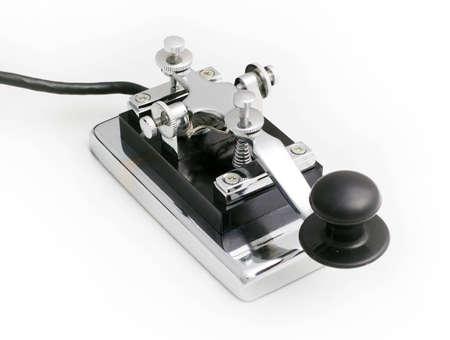 telegraaf: vintage morse telegrafie sleutel met een witte achtergrond Stockfoto