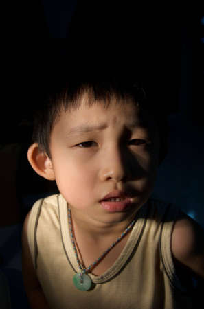 scare: kid scare in the dark low key Stock Photo