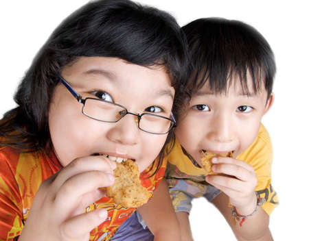 nugget: two kids eating fish and chips snack
