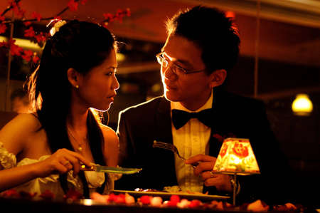 Romantic dinner in low light restaurant -low key photo