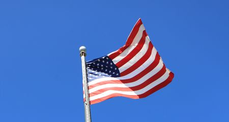 USA flag on mast visible blue sky,outdoor  Photo taken on October 2009 photo