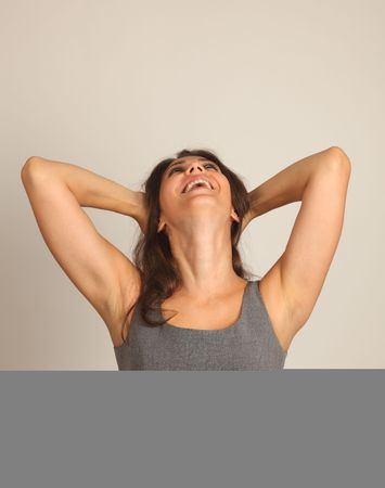 Studio Shot of a Stunning Brunette Laughing Girl with hands up photo