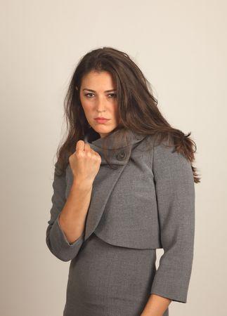 Studio Shot of a Stunning Brunette Girl threatens fist photo