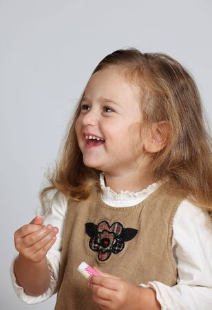 Young Beautifull Girl with lipstick in hand Zdjęcie Seryjne
