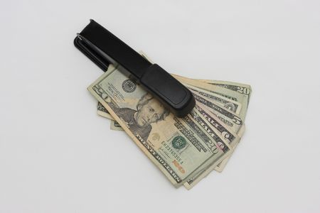 Concept of Financial Crisis, US money with stapler