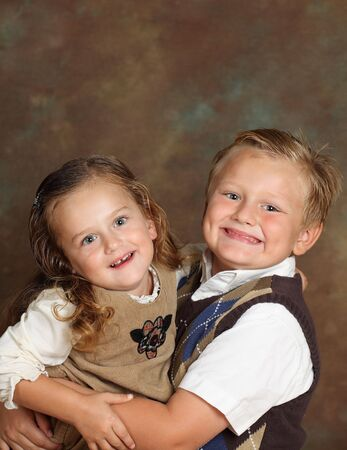 Young boy and girl,sister and brother,studio shot photo