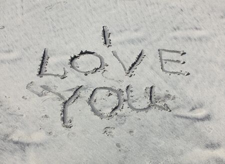 I love you sign on sand, outdoor shot