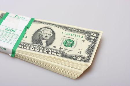 Stack of $2 US bills on white background