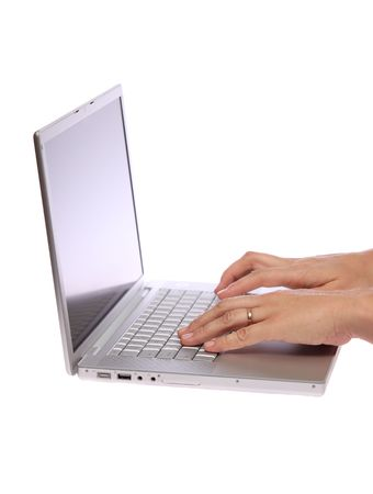 Closeup of a female hand typing on laptop computer on isolated white Stock Photo - 5805918