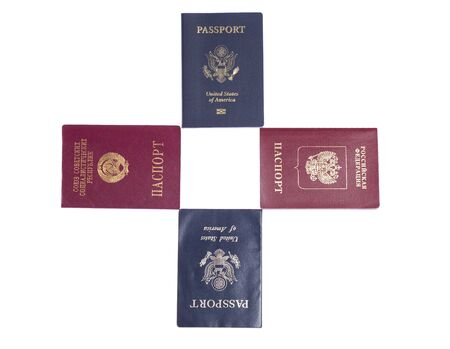 Old US, new US, USSR and Russian passports on white isolated background photo