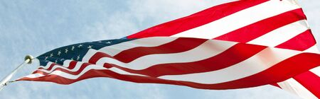 the americas: Photo of American flag waving in the wind