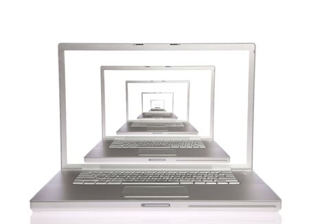 Six  laptops with white screen on white isolated photo
