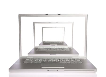 open notebook: Three laptops with white screen on white isolated Stock Photo