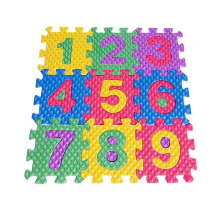 Color numbers from puzzles on white isolated Stock Photo