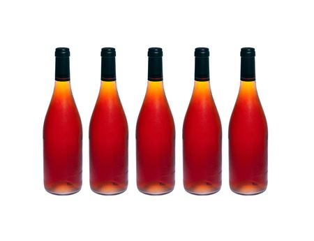 Five  bottles of cold red wine on white isolated photo