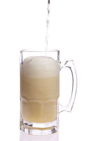 Full glass of beer on white isolated
