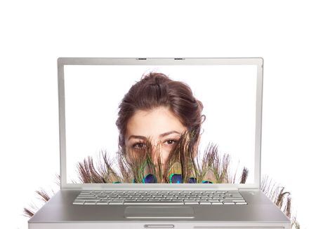 Beautiful female with fan looking through laptop on white isolated photo