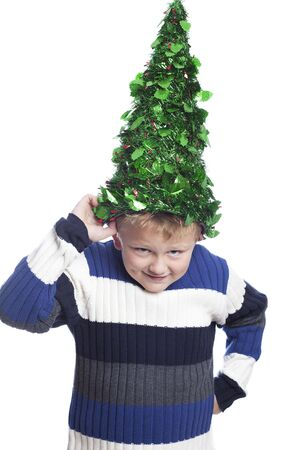 hansome: Six years old hansome boy with christmas tree hat Stock Photo