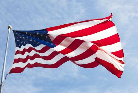 the americas: American flag waving in the wind