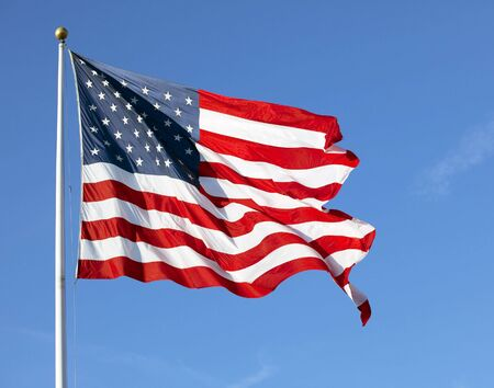 white wave: Photo of American flag waving in the wind