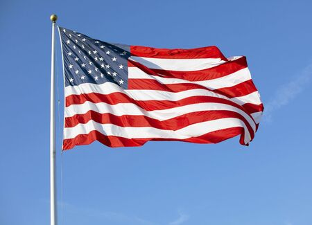 American flag waving in the wind photo